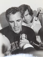 Dave Kempton was a sports information assistant at Notre Dame. Here he's with football coach Ara Paraseghian after a game
