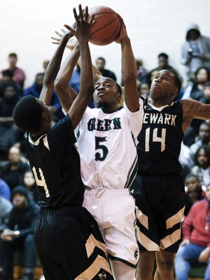 Mount Pleasant's Ny'Jere Hodges (5), shown here against Newark on Feb. 2, scored 19 points to lead the Green Knights in Saturday's Blue Hen Conference championship game