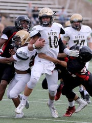 Rider's Jacob Rodriguez is tackled by a several Wichita