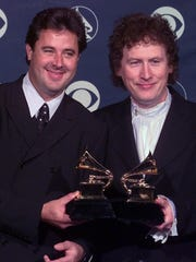 "Vince Gill, left, and Randy Scruggs pose with their Grammys for Best Country Instrumental Performance backstage at the 41st annual Grammy Awards at the Shrine Auditorium in Los Angeles on Feb. 24, 1999. The duo won for ""A Soldier's Joy."""
