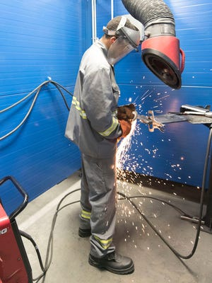 Keanu Osten, a student in the welding program, completes a grinding exercise during class on Wednesday, June 13, 2018. The Welding Training Center is located at 1669 Opportunity Avenue in Cumberland Valley Business Park, Chamberburg.