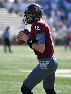 Troy quarterback Brandon Silvers (12) warms up prior to the game against Louisiana-Lafayette at Veterans Memorial Stadium in Troy, Ala. on Saturday, November 29, 2014.