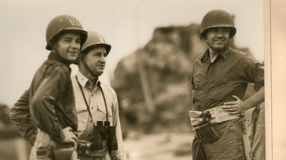 Captain Paul F. Dugan, center, lands at Leyte Gulf in the Philippines in 1944 an hour before MacArthur.