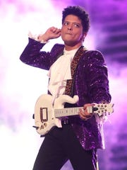 Musician Bruno Mars performs during The 59th Grammy