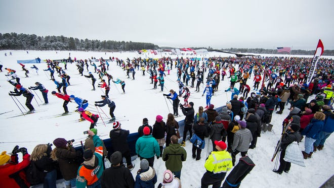 birkie24, spt, lynn, 12-Classic style skiers start the 40th American Birkebeiner cross country ski race from Cable, WI to downtown Hayward.  With over 10,000 skiers it is the largest cross-country ski race in North America. Photo by Tom Lynn