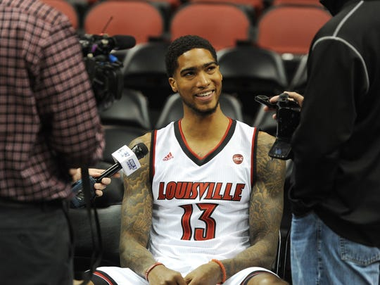 Louisville's Ray Spalding (13) answers questions from