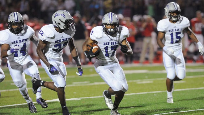 Chris Busbee of BD has a convoy of blockers with him after he picked off a Center Grove pass and returned it for a TD in the fourth quarter. Center Grove hosted Ben Davis in high school football Friday October 4, 2013. Rob Goebel/The Star.