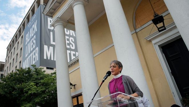 The Rev. Mariann Budde, bishop of Washington's Episcopal diocese, speaks during a service outside St. John's Episcopal Church near the White House on June 19, 2020.