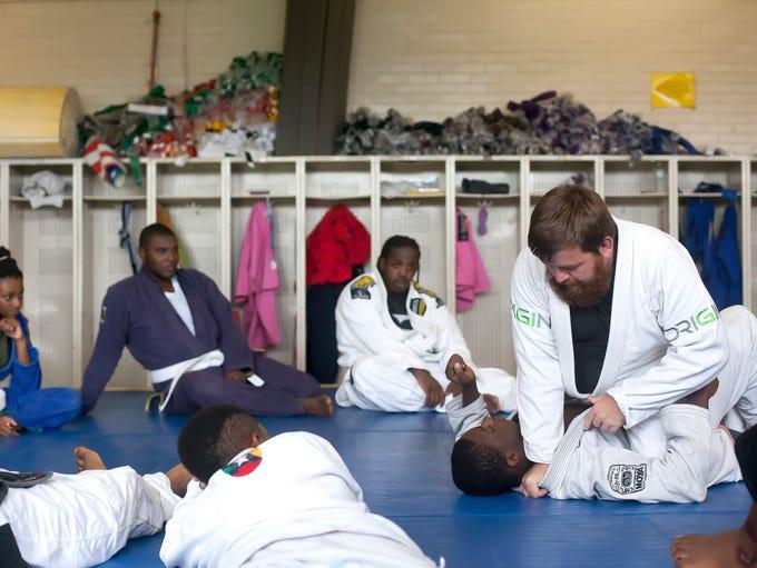Vector Jiu-Jitsu instructor Chris Thrasher shows a