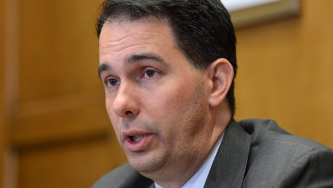 Wisconsin Gov. Scott Walker meets with the Press-Gazette Media editorial board on Wednesday.