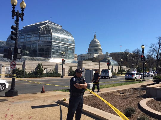 Capitol Hill police stand guard at the Botanical Gardens on Capitol Hill on Washington, Wednesday, March 29, 2017, after a woman struck a U.S. Capitol Police cruiser with a vehicle near the Capitol on Wednesday morning and was taken into custody, police said. (AP Photo/Michael Biesecker)