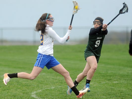 Kennard Dale's Morgan Day  tries to get past the defense of York Catholic's Maura Palandro during the Rams' 14-13 overtime win at Kennard Dale on Monday, April 28, 2014. Jason Plotkin - Daily Record/Sunday News