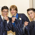 Graduates celebrate Maria Regina High School's 54th commencement ceremony at Our Lady of Shkodra Church, June 6, 2015