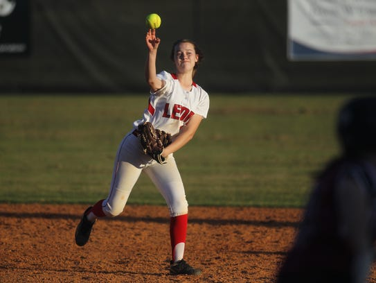 Leon second baseman Christna Hoffman throws to first