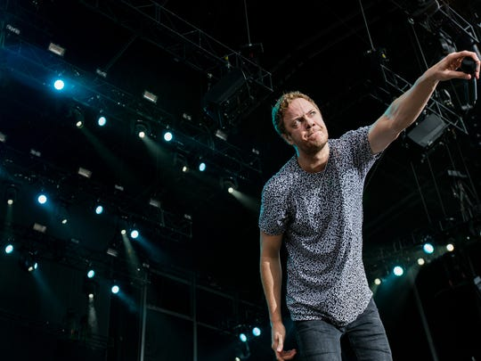 Dan Reynolds performs with Imagine Dragons at the Firefly Music Festival in Dover on Saturday.