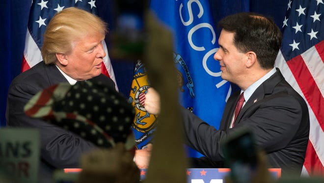 President Donald Trump (left) and Wisconsin Gov. Scott Walker during an appearance at a rally Nov. 1 in Eau Claire.