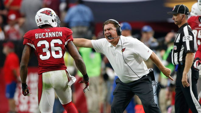 Arizona Cardinals special teams coordinator Amos Jones directs safety Deone Bucannon back on the field against the Eagles during the third quarter of NFL action on Sunday, Oct. 26. 2014, at University of Phoenix Stadium in Glendale, Ariz.
