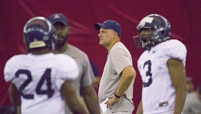 Arizona head coach Rich Rodriguez watches his team during practice at the Cardinals' Training Facility in Tempe on August 10, 2016.