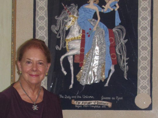 Jeanne with tapestry- July 2014.jpg