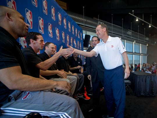 Atlanta Hawks head coach Mike Budenholzer celebrates with his assistant coaches from left, Darvin Hamm, Kenny Atkinson and Taylor Jenkins after he was selected as the NBA coach of the year during a basketball news conference, Tuesday, April 21, 2015, in Atlanta.  (AP Photo/John Bazemore)