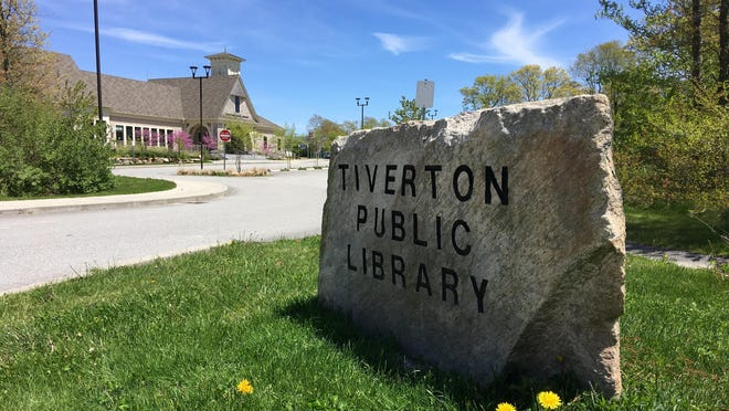 Land behind the Tiverton Public Library has been donated by the town for a dog park.