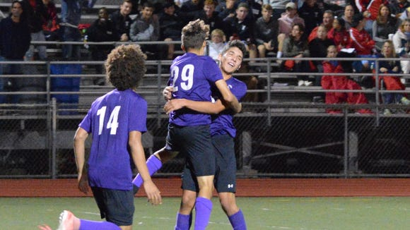 Martine Vargas (29) celebrates with his New Rochelle teammates after scoring the only goal in a win over Somers at the Night of Champions friendly.