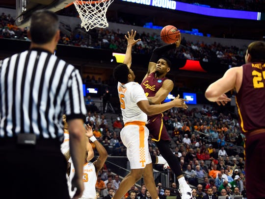 Tennessee forward Derrick Walker (15) defends Loyola-Chicago