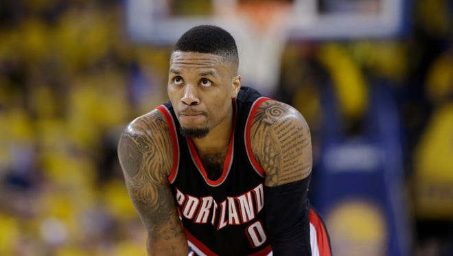 Portland Trail Blazers' Damian Lillard pauses during free throws during the second half in Game 2 of a second-round NBA basketball playoff series against the Golden State Warriors Tuesday, May 3, 2016, in Oakland, Calif. Golden State won 110-99.