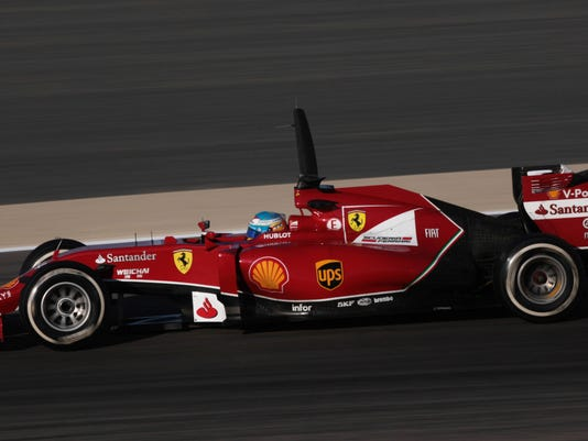 Ferrari driver Fernando Alonso of Spain speeds down the track during Formula One testing at the Bahrain International Circuit in Sakhir, Bahrain, Tuesday, April 8, 2014. (AP Photo/Hasan Jamali)