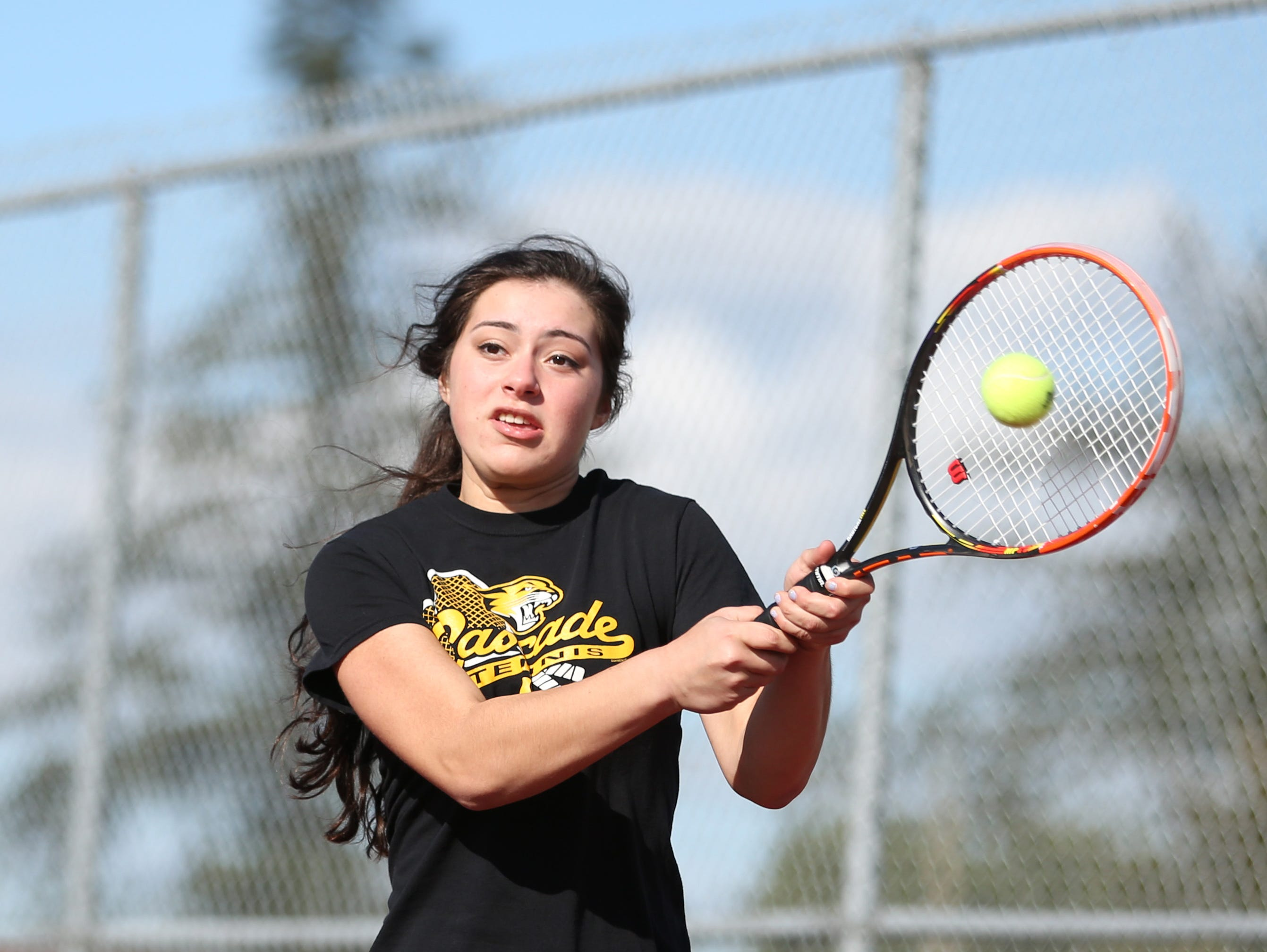 Jaja Osuna Sola practices with doubles partner, Tori Lewis, on Tuesday, March 21, 2017, at Cascade High School in Turner.