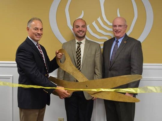 Exclusive Agent David Basile, left, is joined by Chris Edwards, director of business development at Somerset County Business Partnership, center, and Allstate New Jersey Insurance Co. President John Kane for the ribbon-cutting ceremony of his new location in Bound Brook.