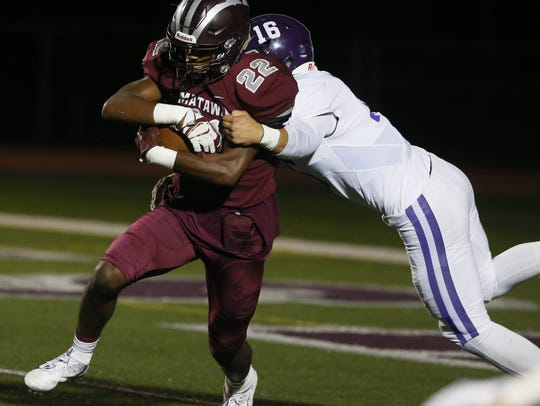Derrick Wiley (22) of Matawan rushes against Christian