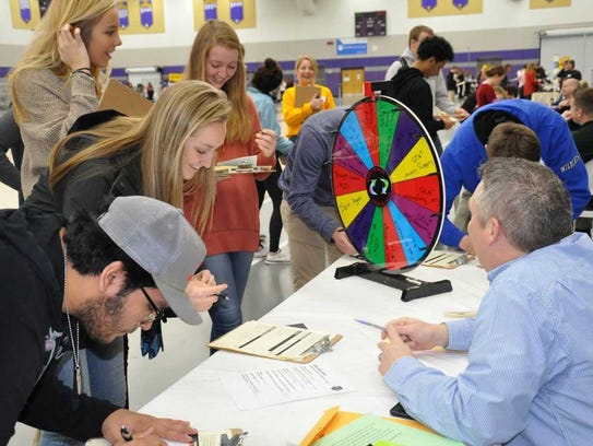 Students participate in the Oconomowoc Reality Store event in February.