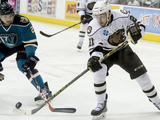 Bears right winger Casey Wellman shoots the puck towards the net and past Worcester's Dylan DeMelo during Hershey's first-round Calder Cup Playoffs series against the Sharks at Giant Center on Wednesday, April 29. The Bears eventually fell to the Sharks, 4-1, but beat them in Game 4 Friday to advance to the Eastern Conference semifinals.