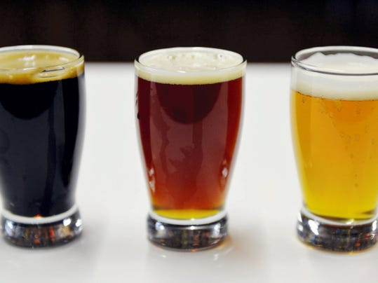 From left to right, Mexitaly Brick Oven Brewhouse's Morning Impact coffee stout, Supernaut Red IPA and Golden Years ale are shown