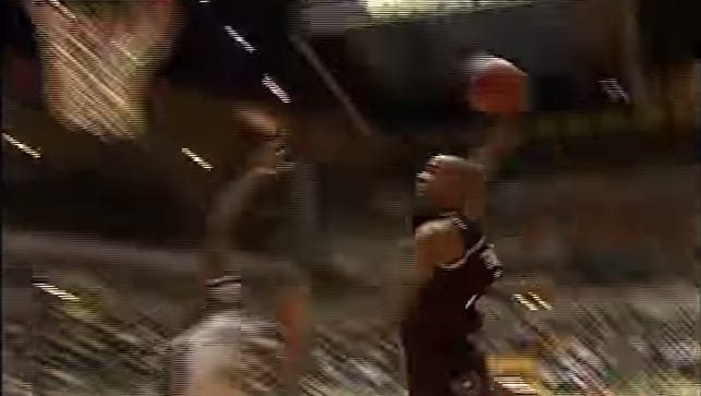 Will Fontleroy prepares to throw down a dunk over Albert White in the Bears' victory over Mizzou in 1999.
