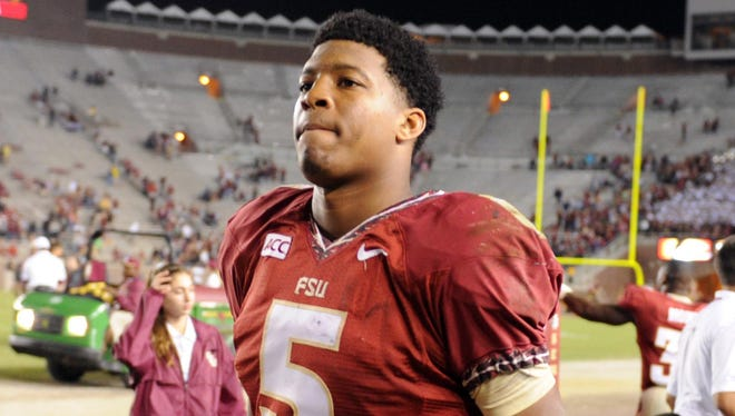 Florida State quarterback Jameis Winston (5) leaves the field after the Seminoles' game Nov. 23 against Idaho at Doak Campbell Stadium.