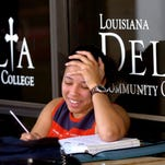 A student studies outside of Louisiana Delta Community College. A study ranked the school at No. 646 in the country, but state officials questioned the methodology.