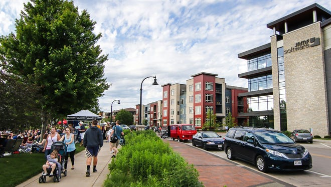 Eau Claire's Phoenix Park (left), which has outdoor concerts and other activities, is a draw for thousands of people. Jamf, an Apple management software company, has offices across the street.