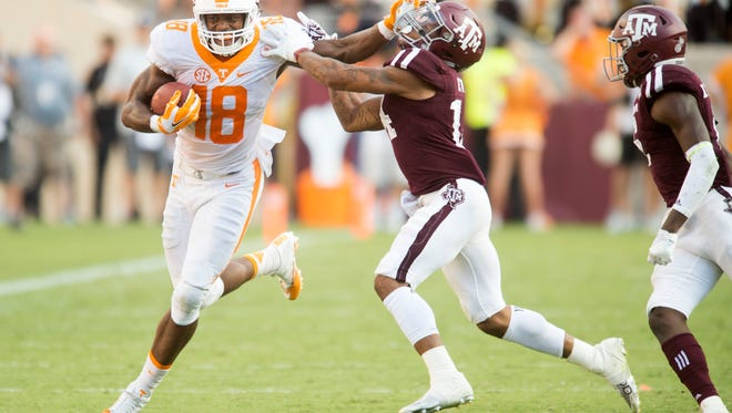 Tennessee tight end Jason Croom, left, tries to fight of Texas A&M defensive back Justin Evans during a game against Texas A&M on Oct. 8.