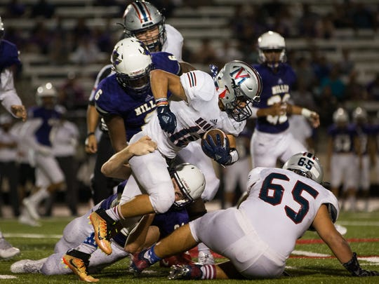 Veterans Memorial's Aaron Lugo is tackled as he runs the ball during the fourth quarter of their game against Miller at Buccaneer Stadium on Thursday, Sept. 28, 2017.
