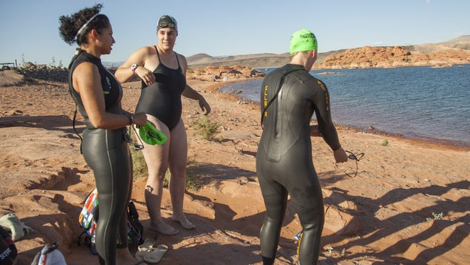 Spectrum Audience Analyst Casie Forbes, center, trains with members of the Southern Utah Triathlon Club at Sand Hollow Reservoir in preparation for the St. George Ironman Thursday, July 16, 2015.