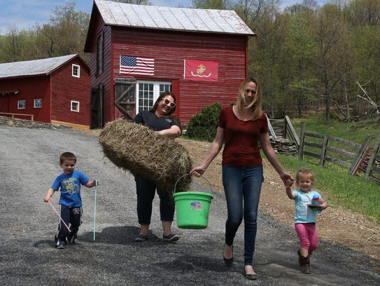 From left, Samantha Coon and her mother, Stacey Higgins, at Old Adriance Farm in Staatsburg on May 7, 2018. They are joined by Samantha's children, from left, Emmett and Lorraine. Samantha and Stacey have been working together in their food truck, and are in the process of starting a farm brewery and wedding venue.