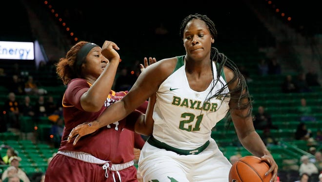 Winthrop's Teylahna Green, left, defends as Baylor's Kalani Brown (21) works to the basket for a shot in the second half of an NCAA college basketball game, Thursday, Dec. 15, 2016, in Waco, Texas.