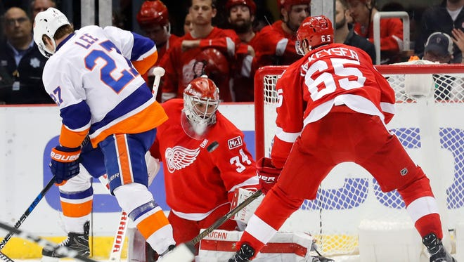 Red Wings goalie Petr Mrazek stops a shot from Islanders left wing Anders Lee while Danny Dekeyser defends in the second period Tuesday, Feb. 21, 2017 in Detroit.