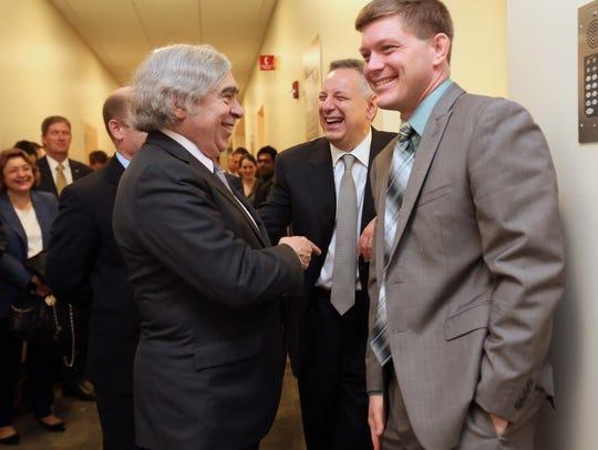 U.S. Secretary of Energy, Dr. Ernest Moniz (left) shares