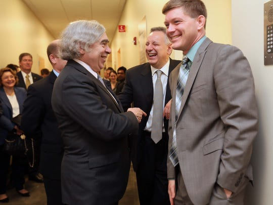 U.S. Secretary of Energy, Dr. Ernest Moniz (left) shares a laugh with Matt Doty (right), an associate professor of materials science and engineering at University of Delaware, and Dennis Assanis (center) during a tour Friday of the school's Patrick T. Harker Interdisciplinary Science and Engineering Laboratory.