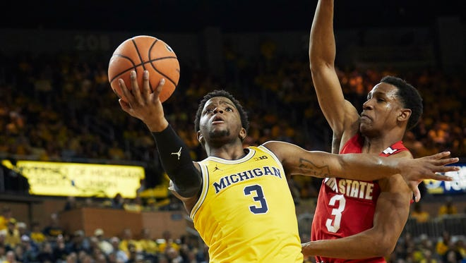 Michigan guard Zavier Simpson (3) goes to the basket against Ohio State guard C.J. Jackson (3) in the first half on Sunday, Feb. 18, 2018, at Crisler Center.