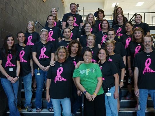 Carrie Smeltzer is shown here with members of Red Lion Area High School's faculty, wearing T-shirts purchased to help defray some of the costs of her treatments.