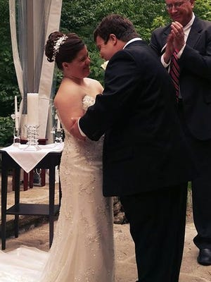 Jillian the Magnificent and her newlywed husband, Ryan Mavriplis, during their wedding ceremony.